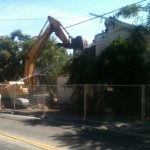 excavator removing house