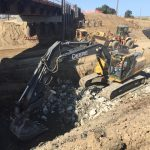 excavator on demolition site